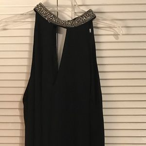 Little black dress. With sequin collar.